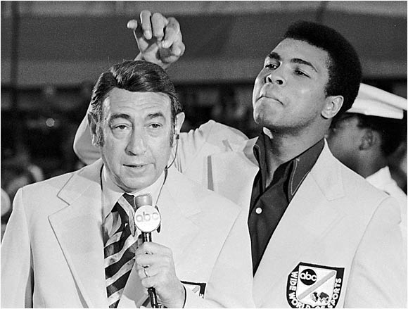 Howard Cosell was also known for his interviews of Muhammad Ali, who plays with the broadcaster's well-coiffed mane here in 1972.