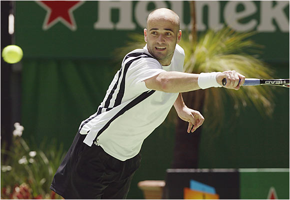 As the two-time defending champ, Agassi missed the `02 Aussie with a wrist injury. In `03, with wife Steffi Graf and son Jaden Gil in the stands, he picked up where he left off, winning in Melbourne for the fourth time in his career.