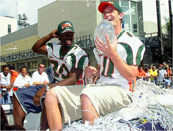 Ken Dorsey  held the national championship trophy as he rode through Miami with teammate Ed Reed during the January 2002 parade in their honor. The Hurricanes were treated to a ticker-tape parade as thousands of fans celebrated their win and undefeated season.