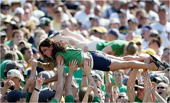 Notre Dame fans celebrate a touchdown by using this student to do human push-ups during a game against Michigan last September.