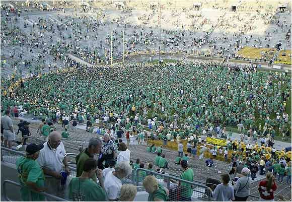 Notre Dame fans celebrated on the field after upsetting Michigan, 28-20, in September, 2004.