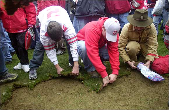 Ohio State fans pulled sod from the Ohio Stadium field after the Buckeyes capped a 13-0 season by defeating Michigan 14-9 on Nov. 23, 2002, in Columbus, Ohio.