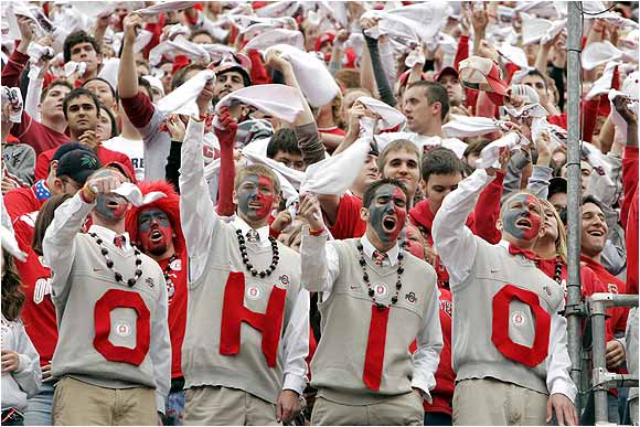 Buckeyes fans, dressed like head coach Jim Tressel, cheered their team on against the Michigan Wolverines in this 2004 match-up between the longtime rivals.
