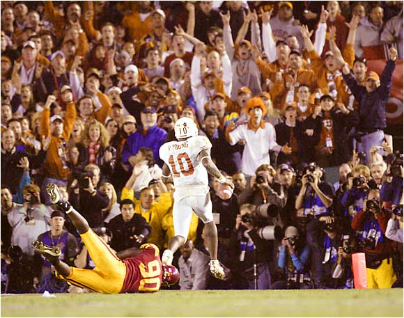 Texas fans cheered QB Vince Young as he ran past USC's Frostee Rucker for the 8-yard TD that secured the Longhorns' national championship. Texas defeated the Trojans,  41-38, at the Rose Bowl last January 4.