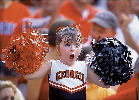A future cheerleader? Time will tell for five-year-old Taylor Compton, who took in this 2002 game against Tennessee.