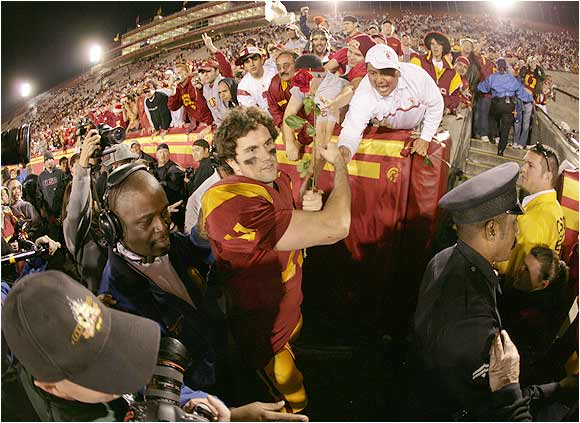 Quarterback Matt Leinart shook hands with happy USC fans in the stands of L.A. Coliseum after the Trojans' 66-19 blowout of UCLA last December.
