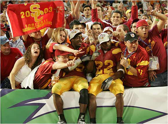 Tailback Desmond Reed (No. 22) and cornerback Eric Wright (25) celebrated with USC fans after trouncing Oklahoma, 55-19, in the 2005 national championship game.