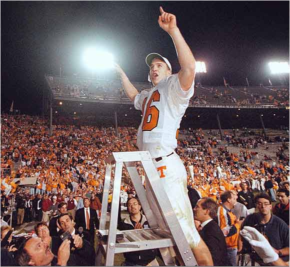 """One of Tennessee's all-time greats, quarterback Peyton Manning, led the fans in a rousing rendition of their fight song """"Rocky Top"""" after the Volunteers beat Alabama 38-21 in an October 1997 game."""
