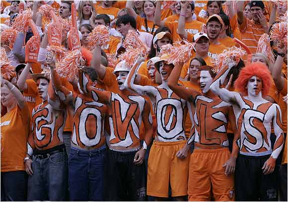 """Close to their hearts: Tennessee fans painted """"Go Vols"""" on their chests during a game against Georgia last October."""