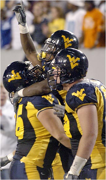 One of the country's best centers, Mozes (left) has a notable mean streak and a motor that won't quit. In his fourth year starting, the 6-foot-4 290-pounder knows the ins and outs of the Mountaineers' blocking schemes. He moved from guard to center in the third game of last season and didn't miss a beat.(left)