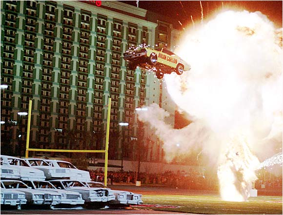 """This is probably not what Henry Ford envisioned. On February 11, 1998, stunt driver Brian Carson shattered his own 298-foot world record for """"auto flight"""" in Las Vegas, soaring 314 feet at 93 mph. The sedan was a specifically constructed vehicle, of course, meaning that you have one more reason out of about a million to never try this at home."""