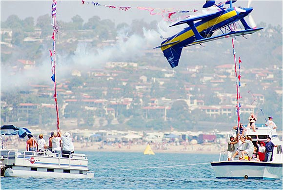 "If it's called the ""Ralphs Unlimited Hydroplane Thunder Tour,"" you can bet that there won't be any run-of-the-mill stunts. In San Diego in 1996, Joann Osterud flew her bi-plane upside-down between two boats in Mission Bay."