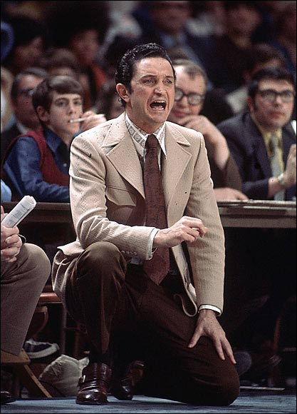 """With McGuire announcing plans to retire as Marquette basketball coach after the 1976-77 season, his impending retirement was no surprise, but few expected his Marquette squad to upset North Carolina (67-59) and win the 1977 national championship. After the game, McGuire did not join the celebration. He sat on the bench by himself, his face buried in his hands, crying. """"I'm not ashamed to cry,"""" he finally said. """"It's just that I don't like to do it in front of people."""""""