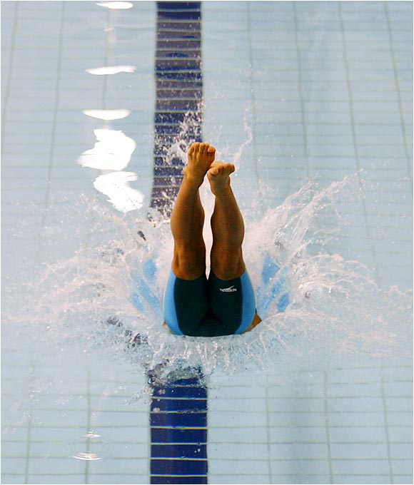 Ping Yuan dives during the men's 100m freestyle at the Pan Pacific Swimming Championships in Victoria, B.C.