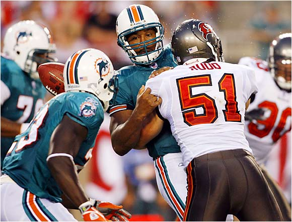 Bucs linebacker Barrett Ruud forces Dolphins quarterback Daunte Culpepper to fumble in a preseason game at Raymond James Stadium.