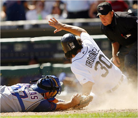 Texas' Rod Barajas tags out the Tigers' Magglio Ordoñez at the plate in the seventh inning of a 7-6 win for the Rangers at Comerica Park.