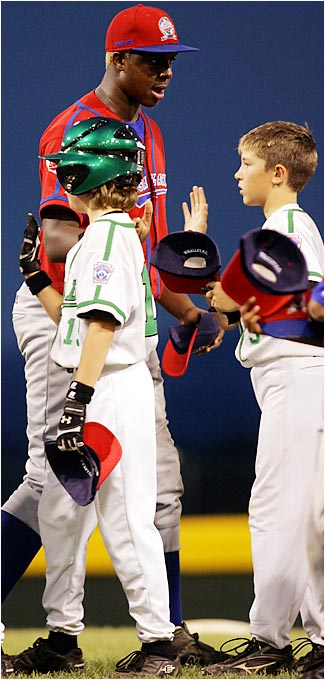 Aaron Durley high-fives Team Canada players after the North Americans lost 5-0 to Saudi Arabia, the Transatlantic champion, during the Little League World Series. Durley has grown four inches since playing at the series last year.