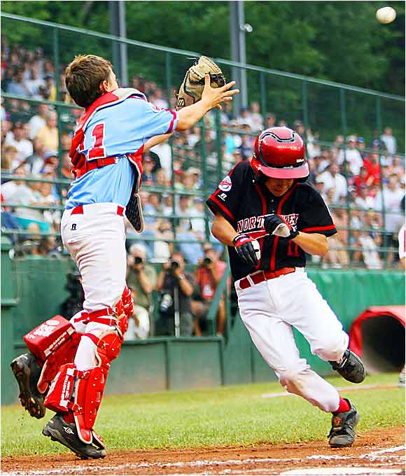 Sam Albert scores on a single by Austin Perry as Cody Walker fields the high throw during a three-run rally by Beaverton in the fourth inning of the U.S. championship game.
