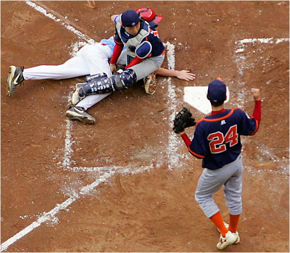 The play at home plate wasn't even close as Kyle Carter failed in his attempt to tie the championship game in the third inning.
