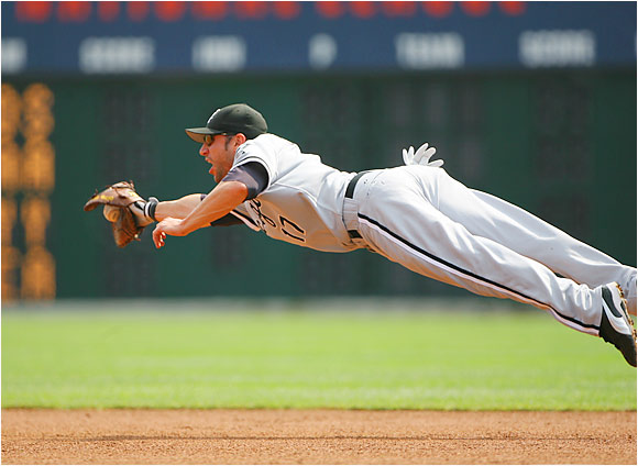 White Sox first baseman Ross Gload dives for a grounder hit by the Tigers' Dmitri Young in the fourth inning at Comerica Park on Aug 24. Paul Konerko has been the DH since Jim Thome was sidelined with a hamstring injury last week, and Gload has filled in nicely at first base for Chicago.