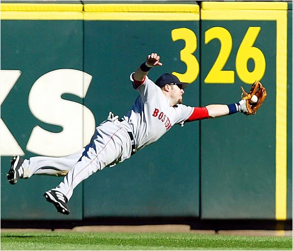 Red Sox right fielder Eric Hinske makes a diving catch on a line out by the Mariners' Rene Rivera in the seventh inning at Safeco Field on Sunday. Seattle won 6-3 to sweep the Sox in three games, leaving Boston 6 1/2 games behind the Yankees in the AL East.