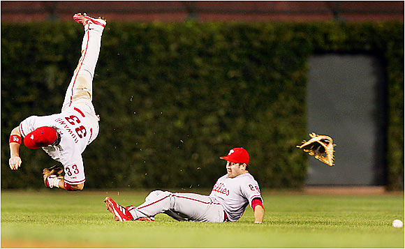 Phillies center fielder Aaron Rowand and second baseman Chase Utley collide after chasing a fly ball at Wrigley Field on Aug. 21. The Phillies won the game 6-5, but Rowand will likely miss the rest of the season after having surgery on a fractured ankle suffered in the collision.