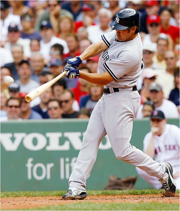 The Yankees' Johnny Damon hits a two-run, fifth-inning homer in Game 1 of a doubleheader against the Red Sox. Damon hit a two-run homer in the second game as well, as the Yankees swept the twinbill.