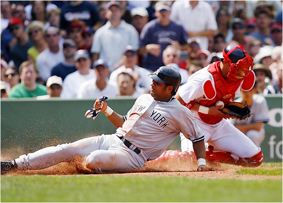 The Yankees' Bobby Abreu slides home safely past Red Sox catcher Javy Lopez after a single by Robinson Cano in the third inning on Aug. 19. At the time, Abreu was batting .397 with 15 walks since coming to the Yankees while Lopez had hit .263 with one walk in 11 games with the Red Sox.