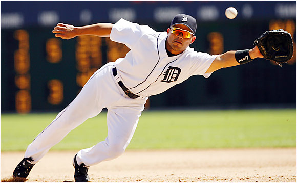 Tigers first baseman Ivan Rodriguez dives in vain to stop a run-scoring double by the Rangers' Garry Matthews Jr. in the fifth inning at Comerica Park on Aug. 20. A catcher his entire career, Pudge has played a handful of games at first base this season and made his first career appearance at second base after an injured Placido Polanco left the game against Boston on Aug. 15.
