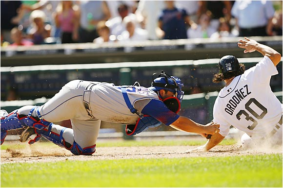 Texas' Rod Barajas tags out the Tigers' Magglio Ordoñez at the plate after a base hit by Brandon Inge in the seventh inning at Comerica Park on Aug. 20. The out prevented Detroit from tying the score in a game that the Rangers won 7-6.