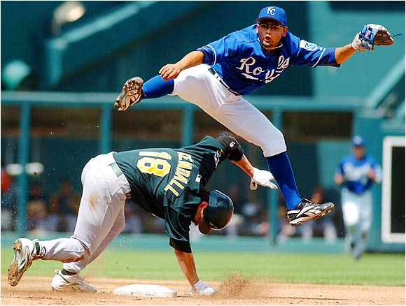 Royals shortstop Andres Blanco turns a double play against A's catcher Jason Kendall in the fourth inning at Kauffman Stadium on Aug. 20. The Athletics won 6-4, handing the Royals their 81st loss of the season. Kansas City is on pace to finish with the worst AL team record for the third consecutive season.