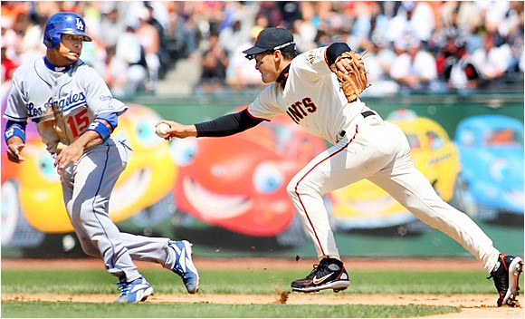 Giants shortstop Omar Vizquel tags out Rafael Furcal for a double play after the Dodger was caught off second base in the fifth inning at AT&T Park on Aug. 20. The Dodgers beat the Giants 5-2 to lead the tight NL West by four games.