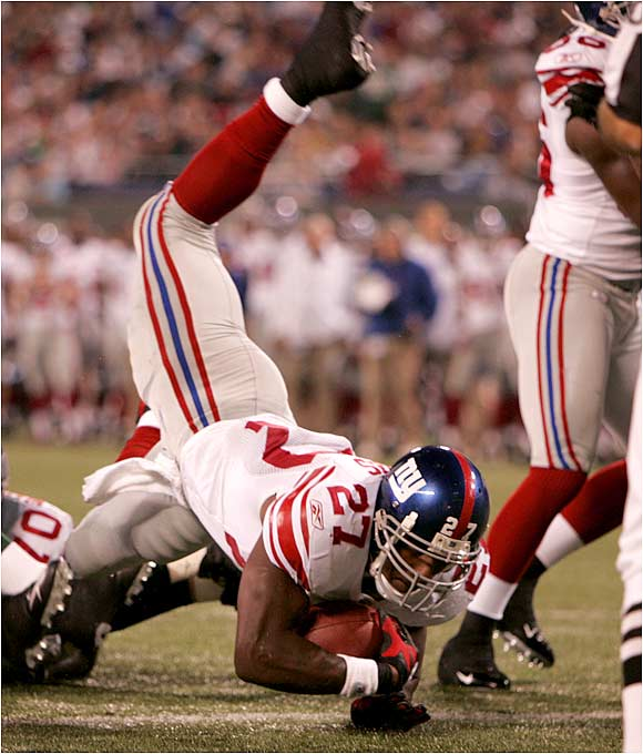 The Giants' Brandon Jacobs scores late in the first half against the Jets. Neither team showed much of an offense as the Giants won 13-7.