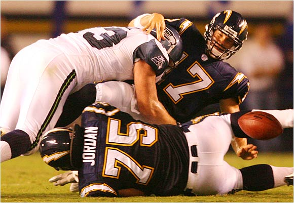 Chargers quarterback Philip Rivers fumbled three times, including this turnover after being hit by Craig Terrill, before leaving with an injured shoulder against the Seahawks.