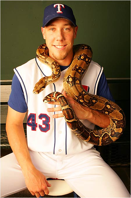 "Loe sometimes brings ""Angel,"" a  7-foot boa constrictor, into the Rangers clubhouse."