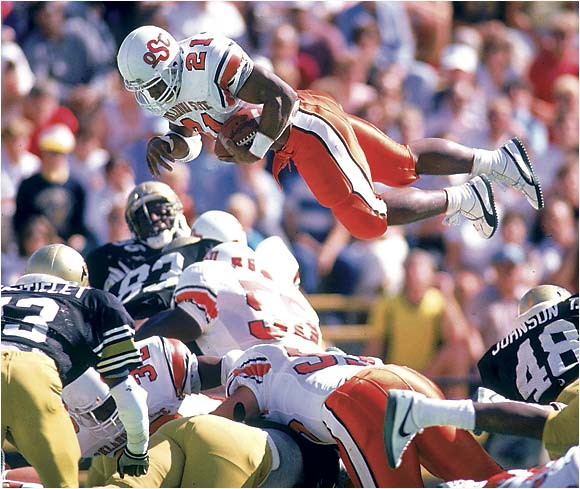 Oklahoma State's Barry Sanders leaping over the Colorado defense on Oct. 8, 1988.