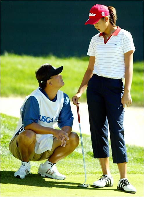 At the 2003 U.S. Women's Open, Wie's father (and then-caddie) B.J. claimed that golfer Danielle Ammaccapane bumped Wie during the first round and also yelled at the then-13-year-old for a lack of course etiquette. B.J. eventually softened his stance while deciding to no longer carry his daughter's bag.
