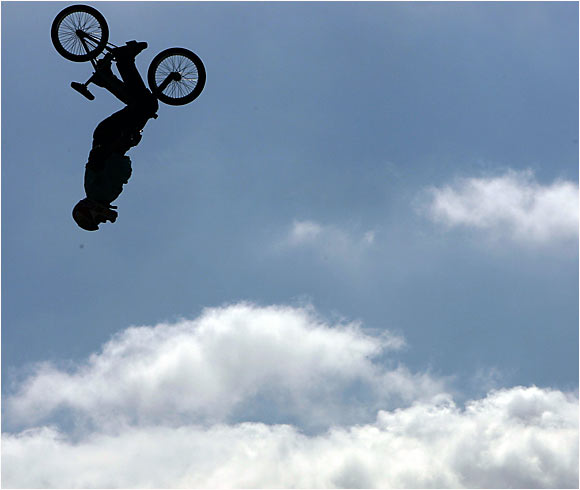 E.T. could learn a few tricks from Robinson, whose backflip tuck, no-hander to no-handed flair won the inaugural BMX Freestyle Big-Air competition. Robinson also struck gold at the BMX Freestyle Vert Best Trick contest, winning a prize that had eluded him for more than a decade.