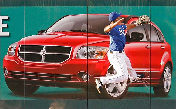 It appears that Royals left fielder Emil Brown got a bad angle on the car.