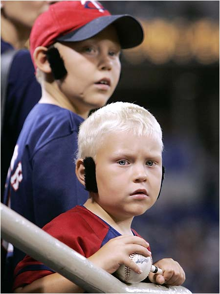 This poor kid is upset because the Twins only handed out dark sideburns on Joe Mauer Sideburns Giveaway day in Minnesota on Thursday.