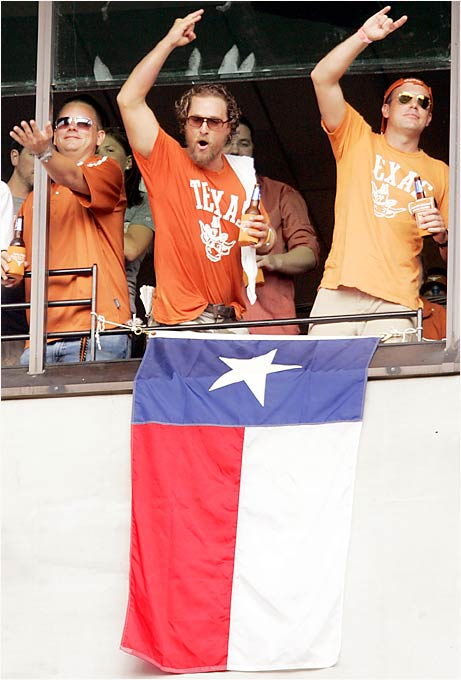 "Matthew McConaughey (center) gave the ""Hook 'Em Horns"" sign before the Texas Longhorns took on the Buckeyes last Saturday."