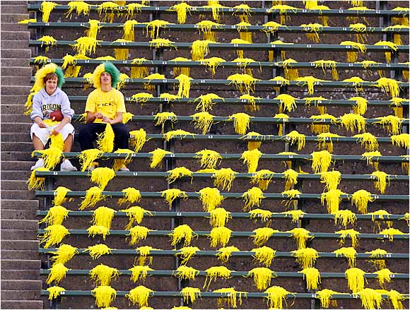 These fans stayed behind after Oregon's victory over Oklahoma, and were surrounded by dozens of empty seats and stray pom-poms.