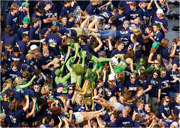 Early in the game, Notre Dame fans were up to their usual crowdsurfing ways after Ashley McConnell caught a three-yard touchdown pass from Brady Quinn in the first quarter of a 47-21 loss to Michigan on Saturday.
