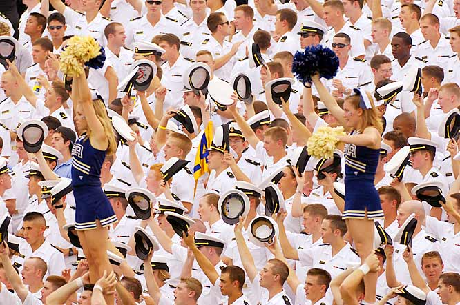 These Navy fans cheer for the Midshipmen, despite the obvious distraction from the Tulsa cheerleaders.