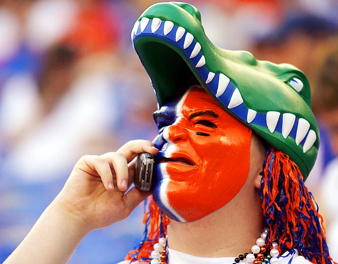 We're not sure whether to praise this Florida fan for the effort he put in getting ready for the game or to criticize him for talking on the phone. Either way, he went home happy as his Gators put the bite on Kentucky, 26-7, at The Swamp.