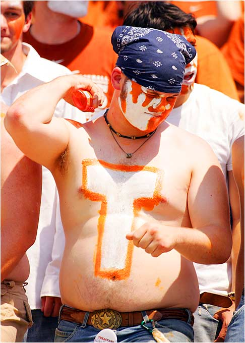 This Texas fan took a break from his busy workout schedule to watch his No. 3 Longhorns defeat North Texas, 56-7, on Saturday.