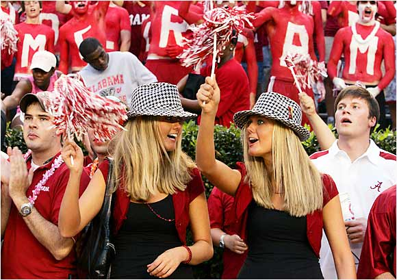 Another set of Alabama women, fetchingly clad in black dresses, enjoyed the Tide's opening game victory over Hawaii on Saturday.