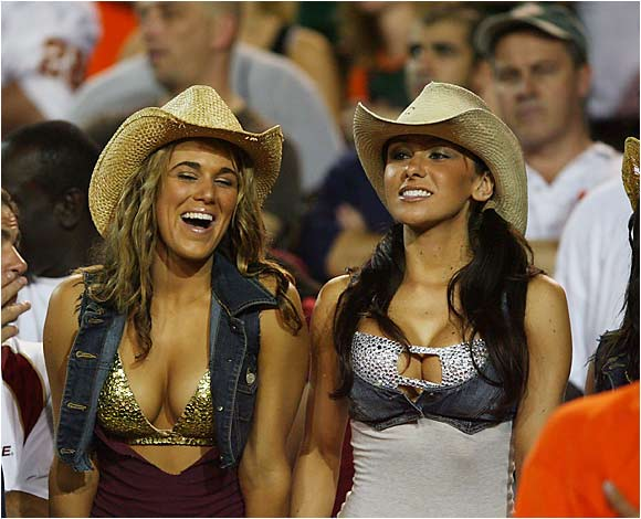 SIOC's own Jenn Sterger (right) enjoys the action from FSU's 13-10 victory over Miami on Monday night.