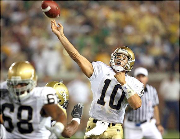 Brady Quinn threw for 246 yards and added a five-yard touchdown run as the Irish survived a trip to Georgia Tech's Bobby Dodd Stadium.