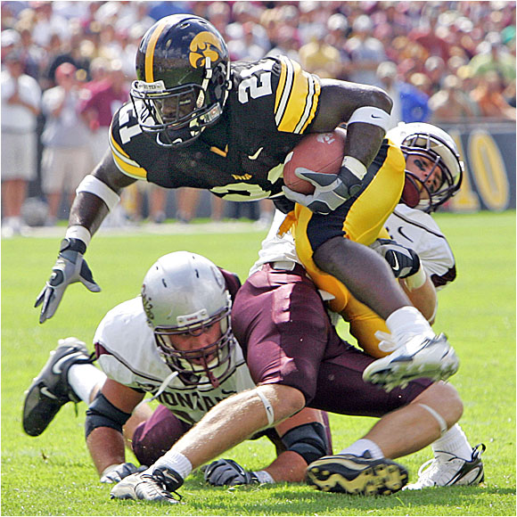 Albert Young ran for 93 yards and a touchdown and caught four balls for 55 yards and a score in the Hawkeyes' rout.